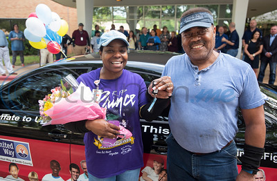 Rita and Herbert Washington of Tyler stand in front of their new car, a Volkswagen Jetta from Patterson Volkswagen, that Herbert won by donating to the United Way of Smith County. The couple work together at the Ingersoll Rand/TRANE company in Tyler and were surprised at work with the announcement on Tuesday May 7, 2019.   (Sarah A. Miller/Tyler Morning Telegraph)