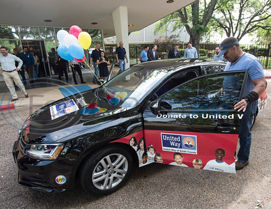 Herbert Washington of Tyler checks out his new car parked outside of his workplace, Ingersoll Rand/TRANE company, on Tuesday May 7, 2019.  Herbert won a Volkswagen Jetta by donating to the United Way of Smith County.   (Sarah A. Miller/Tyler Morning Telegraph)