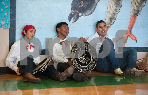 Dogan Middle School students Jose Santibanez, Jairo Barrera and Raul Renteria rest after dancing in the Cinco de Mayo program held at the school in Tyler Friday May 8, 2015. The program featured student dancers, the school band, guest speaker Nick Pesina, Jr. and other special guests.    (photo by Sarah A. Miller/Tyler Morning Telegraph)