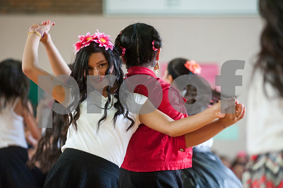 Dogan Middle School eight graders Merari Lagunas and Paola Navarro dance during the Cinco de Mayo program held at the school in Tyler Friday May 8, 2015. The program featured student dancers, the school band, guest speaker Nick Pesina, Jr. and other special guests.    (photo by Sarah A. Miller/Tyler Morning Telegraph)