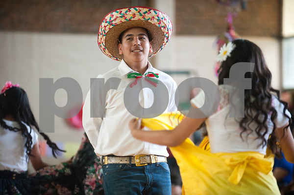 Dogan Middle School eight grader Raul Renteria dances during the Cinco de Mayo program held at the school in Tyler Friday May 8, 2015. The program featured student dancers, the school band, guest speaker Nick Pesina, Jr. and other special guests.    (photo by Sarah A. Miller/Tyler Morning Telegraph)