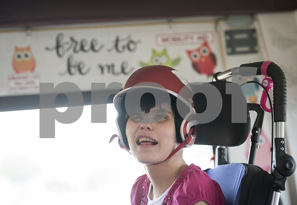 Lulu smiles as she rides on her family's bus to attend her sister Krystal's musical performance at the Boys and Girls Club April 10, 2016. Lulu is blind and has an intellectual disability.   (Sarah A. Miller/Tyler Morning Telegraph)