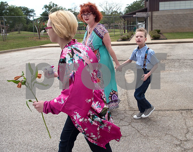 Jessica Ogden and Alfie and Krystal leave the Boys and Girls Club after Krystal's adult daycare musical performance April 10, 2016.   (Sarah A. Miller/Tyler Morning Telegraph)