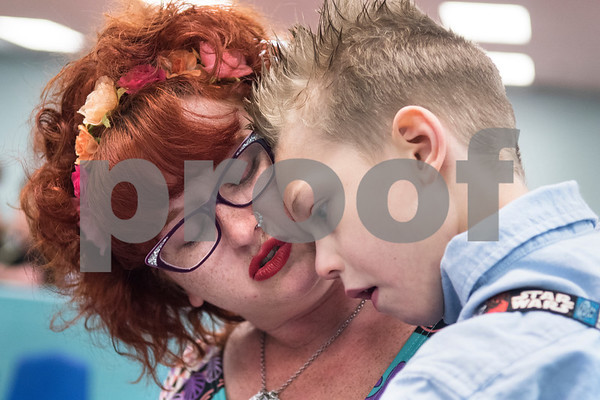 Jessica Ogden carries Alfie, 8, as they wait to watch his sister's musical performance at the Boys and Girls Club April 10, 2016. Alfie loves to be held.  (Sarah A. Miller/Tyler Morning Telegraph)