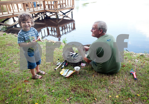 Jackson Ashby, 2, of Flint, fishes with his grandfather Rick Ashby at the Meadow Lake Fishing Derby Friday June 12, 2015. The free event was open to kids and adults of all ages. Prizes were given out to both adult winners and youth winners. Meadow Lake is a retirement community located just south of Tyler in Flint, Texas.    (photo by Sarah A. Miller/Tyler Morning Telegraph)