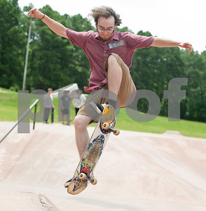 Eric Farris of Whitehouse rides his skateboard Saturday during Training Day at Noble E. Young Skatepark in Tyler. Training Day was a fundraising event put on by the East Texas Skatepark Association to raise money for repairs to Noble E. Young Skatepark and to help people learn to skateboard. Beginning skateboarders paid $20 for one-on-one lessons from local coaches from 11 a.m. to 2 p.m. Basic skills as well as tricks and different riding styles were taught. East Texas Skatepark Association's next event will be a skateboard competition June 27 at noon. Visit www.facebook.com/savenobleskatepark for more information.  (photo by Sarah A. Miller/Tyler Morning Telegraph)
