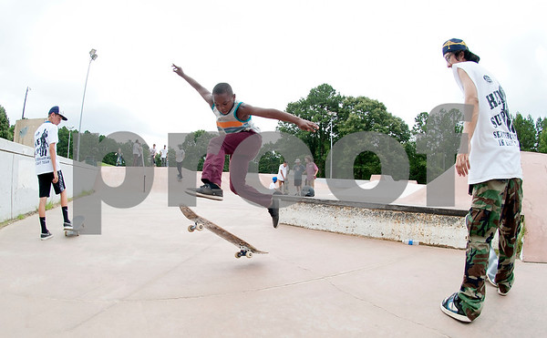 Debraylen McDonald, 8, of Tyler, practices his skateboarding skills Saturday during Training Day at Noble E. Young Skatepark in Tyler. Training Day was a fundraising event put on by the East Texas Skatepark Association to raise money for repairs to Noble E. Young Skatepark and to help people learn to skateboard. Beginning skateboarders paid $20 for one-on-one lessons from local coaches from 11 a.m. to 2 p.m. Basic skills as well as tricks and different riding styles were taught. East Texas Skatepark Association's next event will be a skateboard competition June 27 at noon. Visit www.facebook.com/savenobleskatepark for more information.  (photo by Sarah A. Miller/Tyler Morning Telegraph)