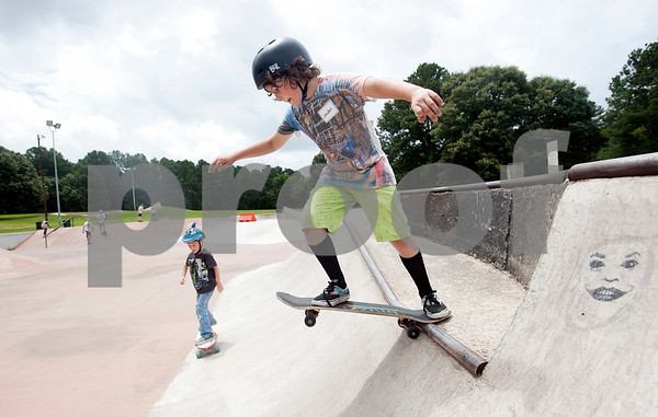 Landen Wright, 9, of Lindale, drops-in on his own after a one-on-one skateboard lesson Saturday during Training Day at Noble E. Young Skatepark in Tyler. Training Day was a fundraising event put on by the East Texas Skatepark Association to raise money for repairs to Noble E. Young Skatepark and to help people learn to skateboard. Beginning skateboarders paid $20 for one-on-one lessons from local coaches from 11 a.m. to 2 p.m. Basic skills as well as tricks and different riding styles were taught. East Texas Skatepark Association's next event will be a skateboard competition June 27 at noon. Visit www.facebook.com/savenobleskatepark for more information.  (photo by Sarah A. Miller/Tyler Morning Telegraph)