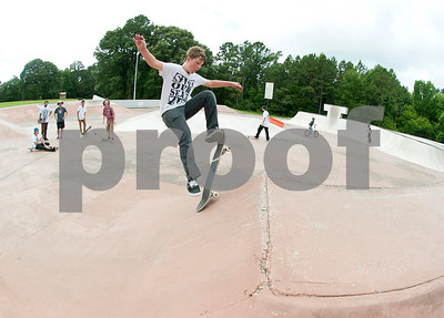 Nolan Jay, 12, of Tyler, practices his skateboarding skills Saturday during Training Day at Noble E. Young Skatepark in Tyler. Training Day was a fundraising event put on by the East Texas Skatepark Association to raise money for repairs to Noble E. Young Skatepark and to help people learn to skateboard. Beginning skateboarders paid $20 for one-on-one lessons from local coaches from 11 a.m. to 2 p.m. Basic skills as well as tricks and different riding styles were taught. East Texas Skatepark Association's next event will be a skateboard competition June 27 at noon. Visit www.facebook.com/savenobleskatepark for more information.  (photo by Sarah A. Miller/Tyler Morning Telegraph)