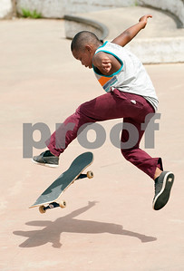 Debraylen McDonald, 8, of Tyler, does a trick on his skateboard Saturday during Training Day at Noble E. Young Skatepark in Tyler. Training Day was a fundraising event put on by the East Texas Skatepark Association to raise money for repairs to Noble E. Young Skatepark and to help people learn to skateboard. Beginning skateboarders paid $20 for one-on-one lessons from local coaches from 11 a.m. to 2 p.m. Basic skills as well as tricks and different riding styles were taught. East Texas Skatepark Association's next event will be a skateboard competition June 27 at noon. Visit www.facebook.com/savenobleskatepark for more information.  (photo by Sarah A. Miller/Tyler Morning Telegraph)