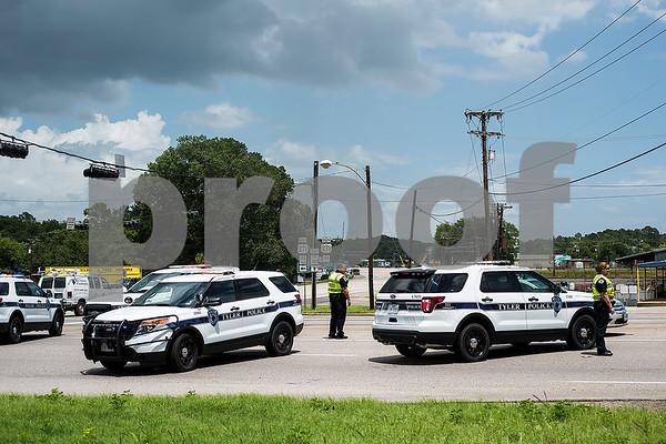 Police block U.S. Hwy 271 due to a fire at Tyler Welders Supply down the road in Tyler, Texas, on Tuesday, June 13, 2017. The fire caused multiple explosions which sent debris flying. (Chelsea Purgahn/Tyler Morning Telegraph)