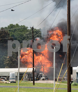 Debris flies in the air during multiple explosions at Tyler Welders Supply in Tyler Tuesday June 13, 2017.  (Sarah A. Miller/Tyler Morning Telegraph)