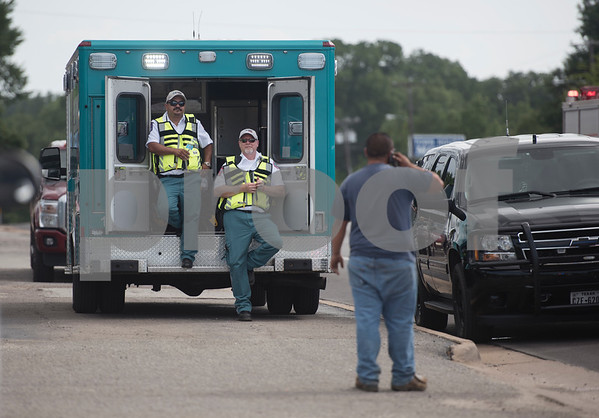 Emergency personnel set up next to the Mobile Command Center during the aftermath of an explosion at Tyler Welders Supply in Tyler Tuesday June 13, 2017.  (Sarah A. Miller/Tyler Morning Telegraph)
