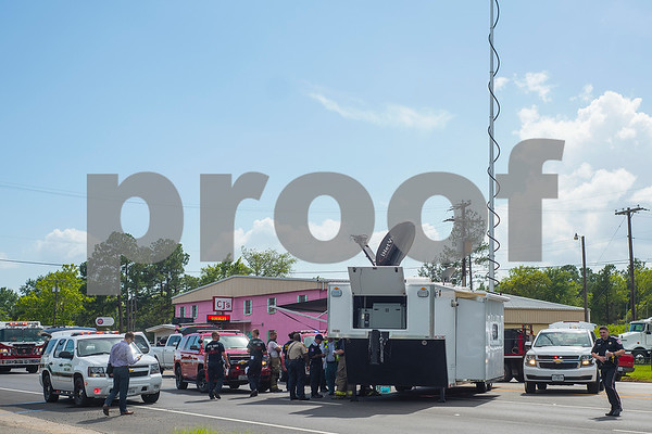 Police and firefighters gather at a mobile command center near the scene of a fire at Tyler Welders Supply in Tyler, Texas, on Tuesday, June 13, 2017. The fire caused multiple explosions which sent shrapnel flying and caused an evacuation of homes and businesses in the surrounding area. No injuries have been reported at this time. (Chelsea Purgahn/Tyler Morning Telegraph)