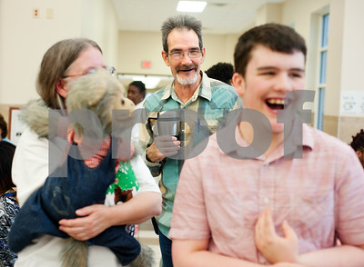 photo by Sarah A. Miller/Tyler Morning Telegraph  Jay Newman, center, watches his son Cody Newman, 17, laugh after seeing teacher Brenda Corley and her monkey puppet at the Tammie Henson Civitan Picnic his school, the Wayne D. Boshears Center for Exceptional Programs in Tyler May 9, 2014. The Boshears Center is a school specialing in providing teaching students with severe and profound disabilities.