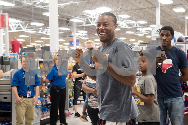 NFL player Teddy Williams dances his way to the start of a shopping spree for four children attending his agility camp at Academy Sports + Outdoors in Tyler on Friday June 15, 2018. Teddy Williams is a John Tyler High School alum. He is holding his free Fast Like Teddy Speed & Agility Camp hosted by Christus Trinity Mother Frances Health System on Saturday June 16 at John Tyler High School. Four camp participants won a $100 shopping spree.   (Sarah A. Miller/Tyler Morning Telegraph)