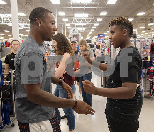 NFL player Teddy Williams dances with Payton Campbell, 13, in the check-out line after a shopping spree Williams hosted at Academy Sports + Outdoors in Tyler on Friday June 15, 2018. Teddy Williams is a John Tyler High School alum. He is holding his free Fast Like Teddy Speed & Agility Camp hosted by Christus Trinity Mother Frances Health System on Saturday June 16 at John Tyler High School. Four camp participants won a $100 shopping spree.   (Sarah A. Miller/Tyler Morning Telegraph)
