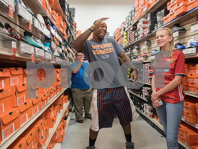 Sofie Williams, 12, has help from NFL player Teddy Williams to shop for soccer cleats during a shopping spree the New York Giants player hosted at Academy Sports + Outdoors in Tyler on Friday June 15, 2018. Teddy Williams is a John Tyler High School alum. He is holding his free Fast Like Teddy Speed & Agility Camp hosted by Christus Trinity Mother Frances Health System on Saturday June 16 at John Tyler High School. Four camp participants won a $100 shopping spree.   (Sarah A. Miller/Tyler Morning Telegraph)