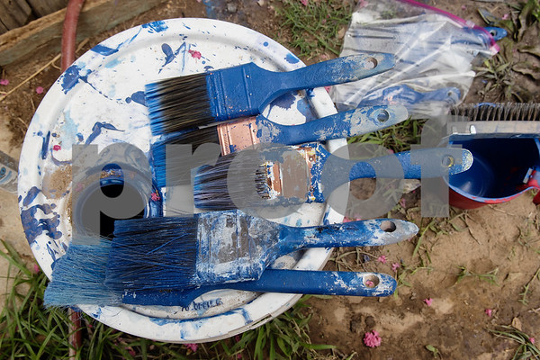 Brushes covered in blue paint sit on a paint bucket outside of the Garcia family home in Tyler on Monday June 18, 2018. The home is being remodeled this week by volunteers from Marvin United Methodist Church's Mission Week ministry. The small home for the family of eight was 480 square feet but will gain an additional 380 square feet with the addition of a two bedrooms.   (Sarah A. Miller/Tyler Morning Telegraph)