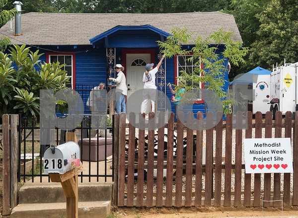 Volunteers including Nadine Grabow, Ann Riley, Betsy Adams and Anne Pattullo paint Alonzo and Demetria Garcia's home in Tyler on Monday June 18, 2018 as part of Mission Week for Marvin United Methodist Church and Pollard United Methodist Church.   (Sarah A. Miller/Tyler Morning Telegraph)
