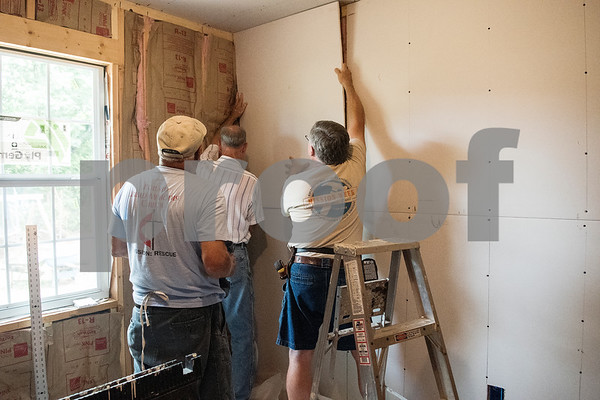 Volunteers from Marvin United Methodist Church and Pollard United Methodist Church build one of two new bedrooms for the Alfonzo and Demetria Garcia's family of eight in Tyler on Monday June 18, 2018. The remodeling is part of the Mission Week ministry. The home was 480 square feet but will gain an additional 380 square feet.  (Sarah A. Miller/Tyler Morning Telegraph)