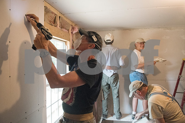 Volunteers from Marvin United Methodist Church and Pollard United Methodist Church build one of two new bedrooms for Demetria Garcia's family of eight in Tyler on Monday June 18, 2018. The remodeling is part of the Mission Week ministry. The home was 480 square feet but will gain an additional 380 square feet.  (Sarah A. Miller/Tyler Morning Telegraph)