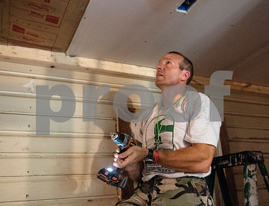 Volunteer Terry Hawkins builds a hallway connected two new bedrooms to a home in Tyler on Monday June 18, 2018. The remodeling is part of the Mission Week ministry. The home was 480 square feet but will gain an additional 380 square feet.  (Sarah A. Miller/Tyler Morning Telegraph)