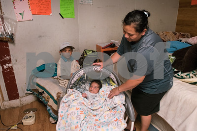 Elias Garcia, 3, his mother Demetria Garcia, and 2-month-old Alonso, get settled at their home after a shopping trip on Monday June 18, 2018. Their home is being remodeled this week by volunteers from Marvin United Methodist Church's Mission Week ministry. The small home for the family of eight was 480 square feet but will gain an additional 380 square feet with the addition of a two bedrooms.   (Sarah A. Miller/Tyler Morning Telegraph)