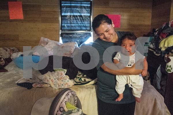 Demetria Garcia holds her youngest child, 2-month-old Alonso, on Monday June 18, 2018 in their home that is being remodeled this week by volunteers from Marvin United Methodist Church's Mission Week ministry. The small home for the family of eight was 480 square feet but will gain an additional 380 square feet with the addition of a two bedrooms.   (Sarah A. Miller/Tyler Morning Telegraph)