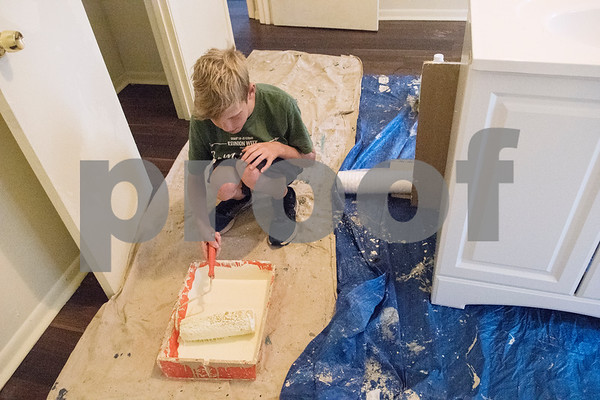 Jared Hosch, 12, uses a paint roller to coat a room in white paint inside a PATH home as part of Middle School Mission Effort on Tuesday June 19, 2018. Middle School Mission Effort is a service event for middle school students from Glenwood Church of Christ in Tyler and Shiloh Road Church of Christ to learn basic service skills such as painting a house. The non-profit organization PATH owns dozens of rental homes in Tyler that are utilized in their transitional housing programs for people earning a low income but who want to gain stability through affordable home renting or ownership.  (Sarah A. Miller/Tyler Morning Telegraph)