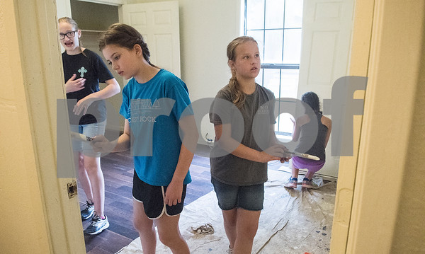 Ava Muns, 11, and Gracie Albritton, 11, paint in a PATH home as part of Middle School Mission Effort on Tuesday June 19, 2018. Middle School Mission Effort is a service event for middle school students from Glenwood Church of Christ in Tyler and Shiloh Road Church of Christ to learn basic service skills such as painting a house. The non-profit organization PATH owns dozens of rental homes in Tyler that are utilized in their transitional housing programs for people earning a low income but who want to gain stability through affordable home renting or ownership.  (Sarah A. Miller/Tyler Morning Telegraph)