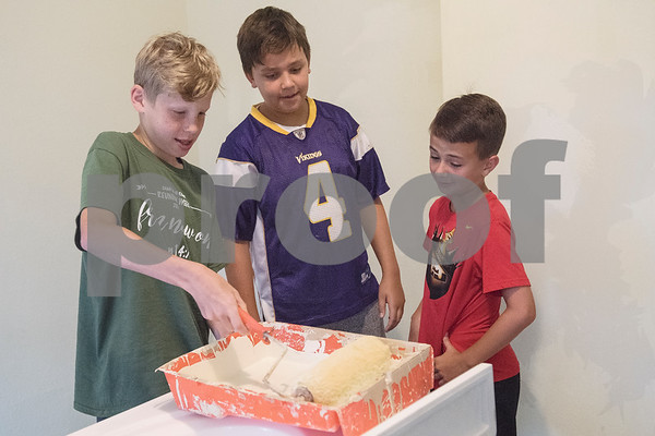 Jared Hosch, 12, Jack Crawford, 11, and Dustin Dossey, 11, learn to use paint rollers to remodel a PATH home as part of Middle School Mission Effort on Tuesday June 19, 2018. Middle School Mission Effort is a service event for middle school students from Glenwood Church of Christ in Tyler and Shiloh Road Church of Christ to learn basic service skills such as painting a house. The non-profit organization PATH owns dozens of rental homes in Tyler that are utilized in their transitional housing programs for people earning a low income but who want to gain stability through affordable home renting or ownership.  (Sarah A. Miller/Tyler Morning Telegraph)