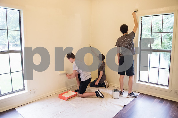 Grant Faulkner, 12, Blaine Laughlin, 13, and Matt Faulkner, 12, coat a room in white paint inside a PATH home as part of Middle School Mission Effort on Tuesday June 19, 2018. Middle School Mission Effort is a service event for middle school students from Glenwood Church of Christ in Tyler and Shiloh Road Church of Christ to learn basic service skills such as painting a house. The non-profit organization PATH owns dozens of rental homes in Tyler that are utilized in their transitional housing programs for people earning a low income but who want to gain stability through affordable home renting or ownership.  (Sarah A. Miller/Tyler Morning Telegraph)