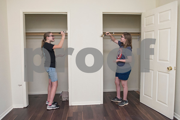 Kaylee Prestidge, 14, and LeeAnna Jones, 13, paint inside two closets in a PATH home as part of Middle School Mission Effort on Tuesday June 19, 2018. Middle School Mission Effort is a service event for middle school students from Glenwood Church of Christ in Tyler and Shiloh Road Church of Christ to learn basic service skills such as painting a house. The non-profit organization PATH owns dozens of rental homes in Tyler that are utilized in their transitional housing programs for people earning a low income but who want to gain stability through affordable home renting or ownership.  (Sarah A. Miller/Tyler Morning Telegraph)