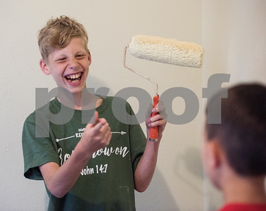 Jared Hosch, 12, laughs as he uses a paint roller with Dustin Dossey, 11, during a remodel effort at a PATH home as part of Middle School Mission Effort on Tuesday June 19, 2018. Middle School Mission Effort is a service event for middle school students from Glenwood Church of Christ in Tyler and Shiloh Road Church of Christ to learn basic service skills such as painting a house. The non-profit organization PATH owns dozens of rental homes in Tyler that are utilized in their transitional housing programs for people earning a low income but who want to gain stability through affordable home renting or ownership.  (Sarah A. Miller/Tyler Morning Telegraph)