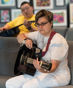 Breckenridge Village of Tyler resident Alex takes a guitar class on Wednesday June 19, 2019. Currently Breckenridge Village of Tyler has two vacant buildings that can house six residents each. The buildings have been vacant because they each need a separate license for residents to move in. There is a waiting list of about 80 people who are interested in becoming residents. Rep. Matt Schaefer authored a new law that will help facilities that serve individuals with intellectual and developmental disabilities such as Breckenridge Village to more easily gain licenses.   (Sarah A. Miller/Tyler Morning Telegraph)