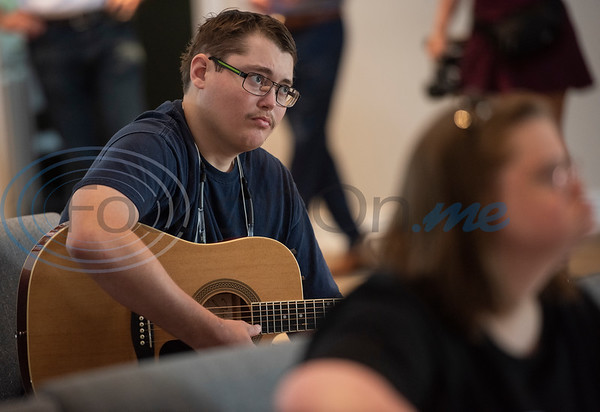 Breckenridge Village of Tyler resident Cody takes a guitar class on Wednesday June 19, 2019. Currently Breckenridge Village of Tyler has two vacant buildings that can house six residents each. The buildings have been vacant because they each need a separate license for residents to move in. There is a waiting list of about 80 people who are interested in becoming residents. Rep. Matt Schaefer authored a new law that will help facilities that serve individuals with intellectual and developmental disabilities such as Breckenridge Village to more easily gain licenses.   (Sarah A. Miller/Tyler Morning Telegraph)