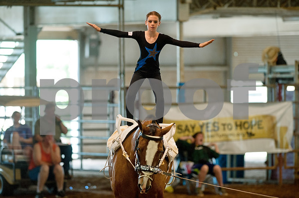 photo by Sarah A. Miller/Tyler Morning Telegraph  Gold Star Pacesetters member Gracie Shepherd, 11, of Maypearl, Texas competes in equestrian vaulting Friday during Super Ride XII: International Festival of the Equestrian held at Texas Rose Horse Park in Lindale, Texas. The five day event features championship competitions in vaulting, equestrian drill, Escaramuza and Quadrille. Equestrian vaulting is described as gymnastics o horseback.