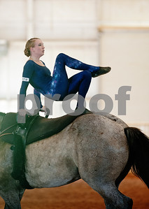 photo by Sarah A. Miller/Tyler Morning Telegraph  Gold Star Pacesetters member Lyndsi Hardin, 24, of Fort Worth, Texas competes in individual freestyle equestrian vaulting Friday during Super Ride XII: International Festival of the Equestrian held at Texas Rose Horse Park in Lindale, Texas. The five day event features championship competitions in vaulting, equestrian drill, Escaramuza and Quadrille. Equestrian vaulting is described as gymnastics o horseback.