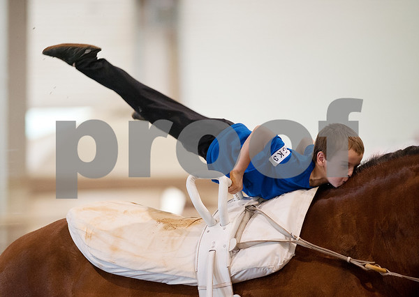 photo by Sarah A. Miller/Tyler Morning Telegraph  Charlie Shepherd, 8, of the Burleson, Texas based Gold Star Pacesetters competes in equestrian vaulting Friday during Super Ride XII: International Festival of the Equestrian held at Texas Rose Horse Park in Lindale, Texas. The five day event features championship competitions in vaulting, equestrian drill, Escaramuza and Quadrille. Equestrian vaulting is described as gymnastics o horseback.