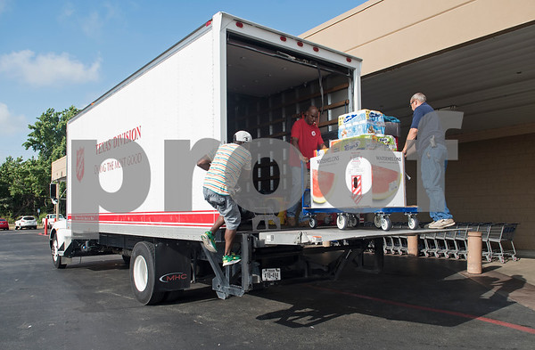 Items from the Deion Sanders shopping spree at Sam's Club are loaded into a Salvation Army truck in Tyler Tuesday June 20, 2017. The goal of the event was to collect up to $10,000 in merchandise in two minutes or less to provide relief to the victims of the Canton area tornadoes April 29, 2017.  (Sarah A. Miller/Tyler Morning Telegraph)