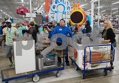 Employees ring up items after the Deion Sanders shopping spree at Sam's Club in Tyler Tuesday June 20, 2017. The goal of the event was to collect up to $10,000 in merchandise in two minutes or less to provide relief to the victims of the Canton area tornadoes April 29, 2017.  (Sarah A. Miller/Tyler Morning Telegraph)