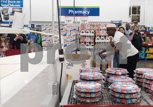Pro Football Hall of Famer Deion Sanders goes on a shopping spree at Sam's Club in Tyler Tuesday June 20, 2017. The goal of the event was to collect up to $10,000 in merchandise in two minutes or less to provide relief to the victims of the Canton area tornadoes April 29, 2017.  (Sarah A. Miller/Tyler Morning Telegraph)