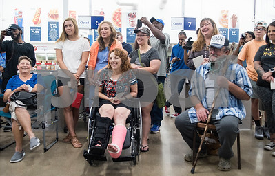 Tornado survivors from Canton and Fruitvale watch the Deion Sanders shopping spree at Sam's Club  in Tyler Tuesday June 20, 2017. The goal of the event was to collect up to $10,000 in merchandise in two minutes or less to provide relief to the victims of the Canton area tornadoes April 29, 2017.  (Sarah A. Miller/Tyler Morning Telegraph)