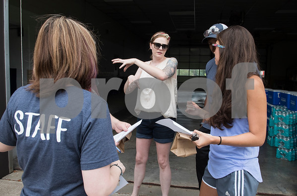 Nora Schreiber, the founder of The Worthy Ones, a Tyler nonprofit, directs volunteers to place coolers filled with cold water bottles at 30 of the most heavily used bus stops in Tyler Tuesday June 20, 2017.  (Sarah A. Miller/Tyler Morning Telegraph)