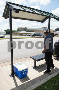 Cameron Royall helps deliver coolers filled with cold bottled water to  bus stops in Tyler Tuesday June 20, 2017.  (Sarah A. Miller/Tyler Morning Telegraph)