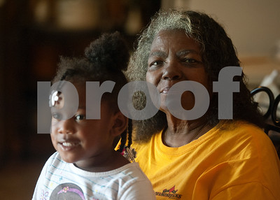 photo by Sarah A. Miller/Tyler Morning Telegraph  Jazmine McCin, 3, sits on her great great grandmother Polly Jackson's lap Thursday May 29, 2014. Jackson, 76, has raised her children, grand children, great grandchildren and great great grandchild at her Winona home.