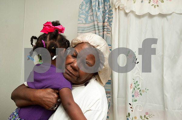 photo by Sarah A. Miller/Tyler Morning Telegraph  Pictured March 27, 2013, Polly Jackson, then 75, hugs her great great granddaughter Jazmine McCin, 2, after McCin threw a temper tantrum as Jackson bathed her in the shower. Jackson is the caregiver for many relatives in her family.