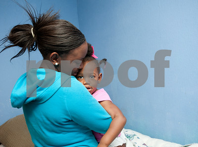 photo by Sarah A. Miller/Tyler Morning Telegraph   Pictured March 27, 2013, Khamila Bradford, then 15, holds her daughter Jazmine McCin, 2, in the morning before leaving to go to high school.