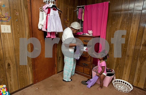 photo by Sarah A. Miller/Tyler Morning Telegraph   Pictured March 27, 2013, Polly Jackson, then 75, helps her great great granddaughter Jazmine McCin, 2, get dressed at her home in Winona, Texas. Jackson is the caregiver for McCin, McCin's mother Khamila Bradford and Bradford's brother Keveonte Bradford.